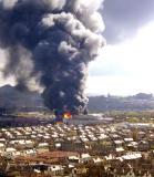 Aeriel view of the fire at Bruce Peebles' works ,  looking to the SE  -  12 April 1999