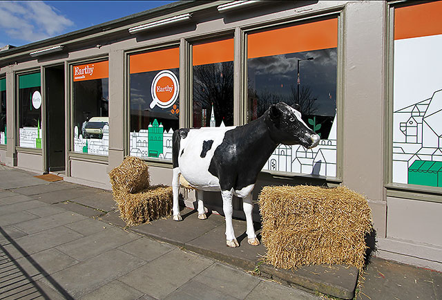 Earthy Fresh Food shop and Restaurant  -  with a cow and hay outside