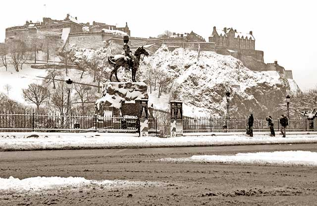Looking to the south across Princes Street  -  Royal Scots Greys Statue and Edinburgh Castle