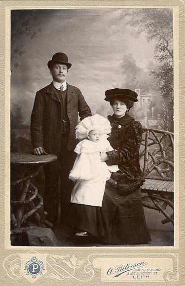 A cabinet print from the studio of A Paterson, Leith  -  A couple and a baby