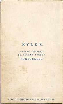 The back of a carte de visite  -  Kyles  -  36 Regent Street  -  Lady, book and pillar