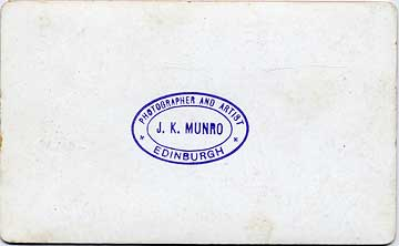 The back of a Photo by JK MUnro mounted on a carte de visite card