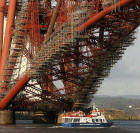 Zoom-in to a photograph of 'Maid of the Forth' passing under the Forth Bridge   -  October 30, 2005