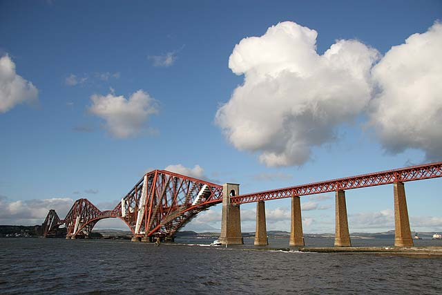 Cloud over the Forth Rail Bridge. A diesel hauled train approaches Dalmeny
