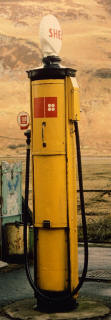 Zoom-in to an old Shell petrol pump in the Scottish Highlands  -  still in use in the 1980s