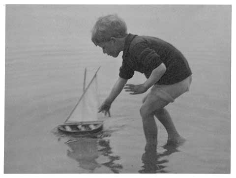 Photograph by AH Maclucas of his son, Norman - boat sailing