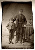 Unframed quarterplate tintype photograph of a man, a boy a nd a trophy
