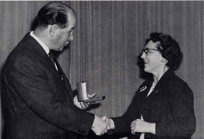 EPS President, George Paterson, makes a presentation of a gold watch to  to Grace Alison - 1964