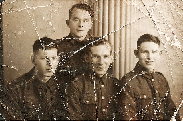 Four  brothers, all members of theScots Guards, taken at Jerome's Studio, 79 Leith Street, in 1939