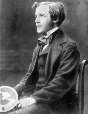 James Clerk Maxwell as a young man; holding his top, showing how colours can be mixed to give white