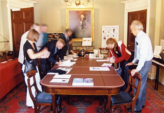 Members of the Scottish Society for the History of Photography (SSHoP) sign the Visitors' Book at the James Clerk Maxwell Museum at James Clerk Maxwell's birthplace - 14 India Street