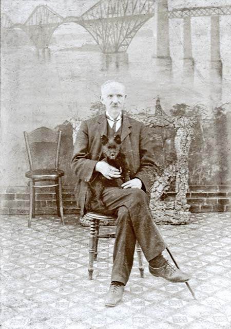Studio portrait by Peter McGill, South Queensferry, with a backdrop of the Forth Bridge