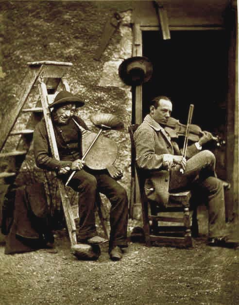 "Thomas Rodger [sen.] - Playing the bellows"" seated beside the Hungarian violinist, Edouard Remeny."