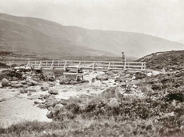 Photograph from the family of Horatio Ross  -  Hunting and Shooting in the Scottish Highlands  -  Crossing the wooden bridge