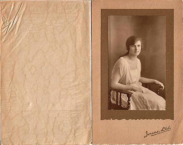 A folder containing a postcard portrait of Nancye Freeman taken in Jerome's Studio