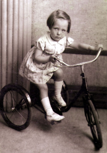 Photo taken in Jerome Studio, Leith Street, Edinburgh  -  Ellen Davie on a tricycle, around 1939-40