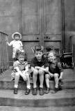 4 young children on the steps in Albany Street  -  Around 1945-46