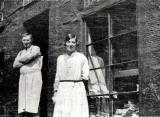 David Drysdale and his daughter outside his baker's shop at 21 Arthur Street, around 1937