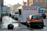 A snack van in Bath Road close to the entrance to Leith Docks.  This view looks towards Salamander Street  -  31 October 2005