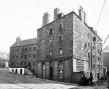 Tenements and Pub at 7-21 Canon Mills, on the site where the Esso Petrol Station now stands