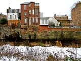 Looking east across the Water of Leith to the backs of the buildings in Dean Bank Lane, Stockbridge  -  December 2009