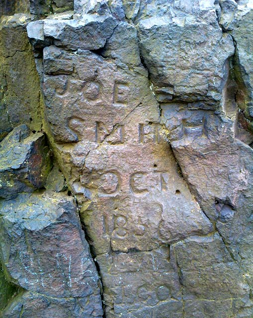 Letternig carved into the rock near the top of Arthur's Seat