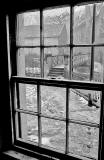 View through the window of one of the houses beside the footbridge over the Water of Leith at Dean Village