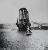 A Yacht sails past the Forth bridge, under construction