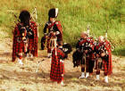 "Pipers gather in Hunter's Bog on Arthur's Seat in Queen's Park preparing to take part in the ceremony of ""Beating the Retreat"" on 17 August 2003"