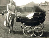 Keith Flockhart in pram with his grandmother,  Keddie Gardens, Leith - around 1958
