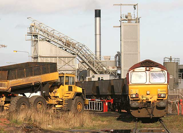 A freight train of empty coal wagons reverses into Leith Docks to piick up imported coal for delivery to power stations