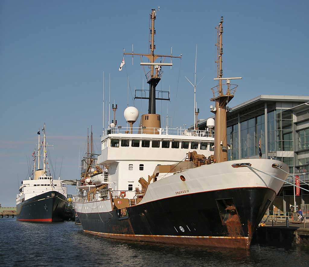 The Royal Yacht Britannia and the Northern Lighthouse Board ship, Pharos IX, moored in Leith Western Harbour beside Ocean Terminal