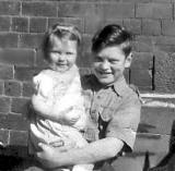 John Stewart and cousin Eveline, on the balcony  car seat given by 'Wingy' Robertson