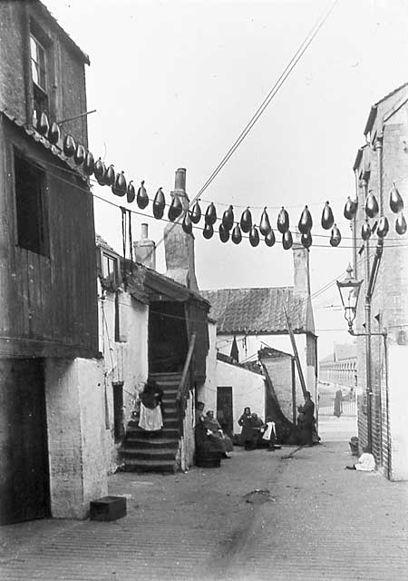 Newhaven Streets  -  Wester Close with sheeps bladders hanging on lines  -  1880s