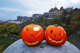 Haloween  -  Two pumpkins placed on the large stone at the SE corner of The Mound Precinct -  Edinburgh Old Town and former Bank of Scotland Head Office are in the background