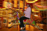 Polina Smirnoff from Moscow on the Galloping Horses Christmas Carousel beside the Scott Monument in East Princes Street Gardens