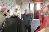 Kenneth Williamson tells a group from the Cockburn Association about the history of Granton Gas Works Station.  This photo was taken from the lower level of the building, standing on one of the old platforms