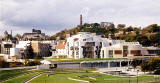 The Scottish Parliament Building  -  with Calton Hill in the background