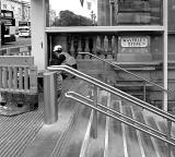 Waverley Steps with a worker completing the work following the installation of escalatorsr  -  February 2012