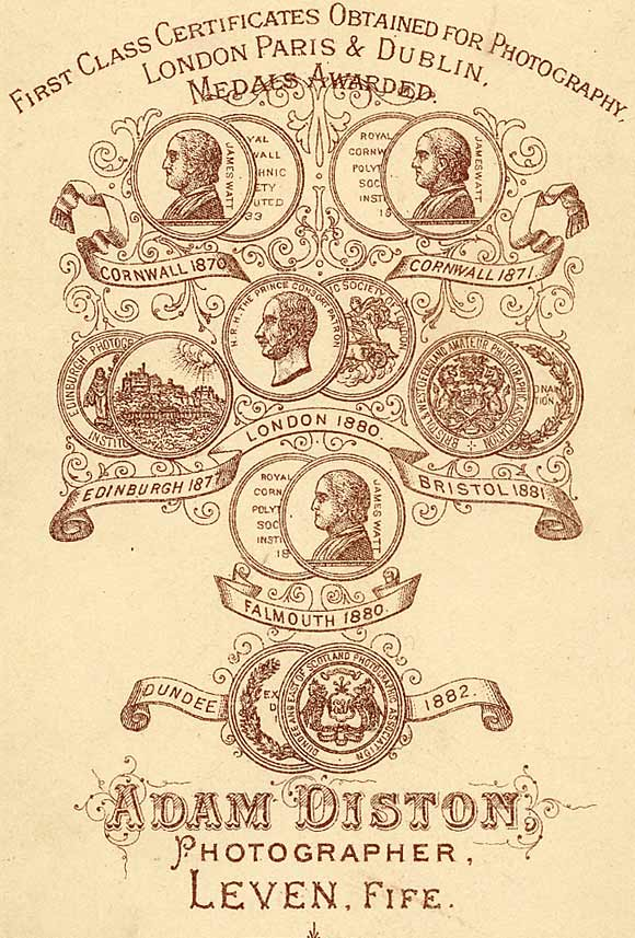 Zoom-in to the back of a carte de visite depicting 7 medals awarded to Adam Didton