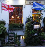 Photos taken in Edinburgh on voting day in the  Scottish Indepemdence Referendum on 18 September 2014  -  Flags at Broughton