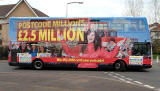 Lothian Buses  -  Adverts on Buses - Postcode Lottery advertised on a bus standing at Route 14 terminus