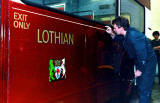Gold Line being applied to Lothian Bus No.522 at the Paintshop at Seafield.