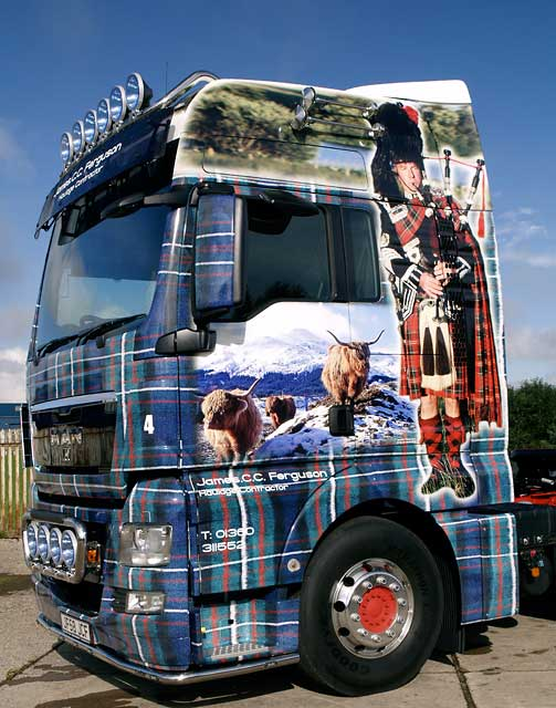 Truck decorated with photos, including my photograph of highland cattle in the snow, near Crianlarich