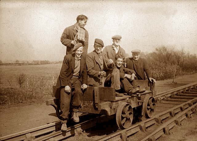 Six railway workers on a trolley  -  Photograph probably taken in the 1950s