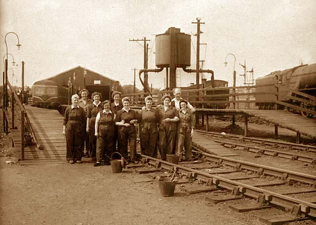 Ten railway cleaners and three buckets  - This photograph was probably taken in the 1950s
