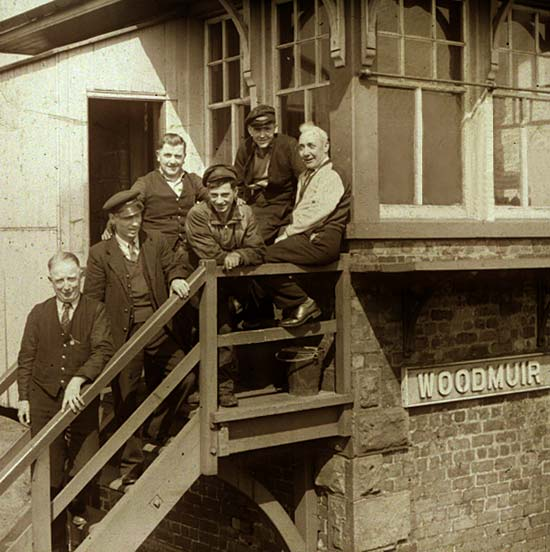 Six workers on the steps of Woodmuir Junction Signal Box in West Lothian