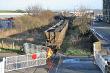 A coal train from Leith Docks has just passed throught the level crossing at Seafield, at the junction of Seafield Road and Marine Esplanade