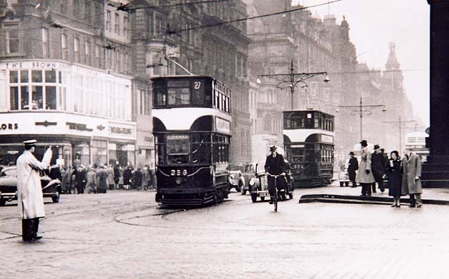 Trams and other traffic in Princes Street at the foot of the Mound