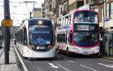 Tram and Bus in Princes Street, mid-March 2014.  The bus is in the branded  livery for Route 22